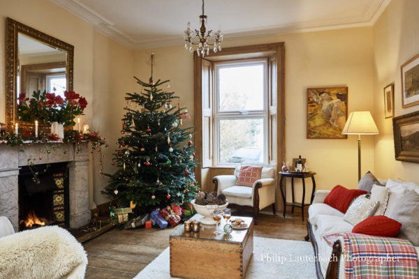 beautiful living rooms at christmas big room design ideas in a restored victorian terraced house open plan with timber flooring chandelier tree presents couch floor lamp lounge chair fireplace decorations