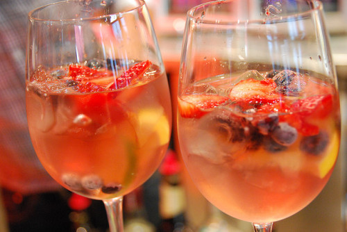 Rosé Sangria Recipe   2 bottles of rosé wine    1 cup white rum (or Sprite to cut down the alcohol) 1/3 cup Grand Marnier 1/2 cup orange juice 1/3 cup sugar   1 cup sliced strawberries  2 peaches, thinly sliced 1 lemon, thinly sliced, seeds removed 1 lime, thinly sliced  Handful of blueberries Handful of raspberries Instructions: Combine all ingredients except fruit in a large pitcher. Stir until sugar is dissolved. Add fruit. Refrigerate. Enjoy! [via:hitchcockismyhomeboy:divinesecrets:muchtoyourchagrin:simplyjess]