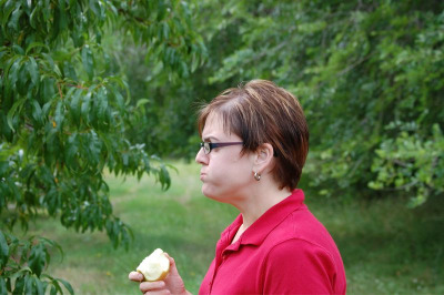 Eating Apple in the Orchard