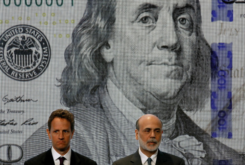 Treasury Secertary Timothy Geithner (left) and Federal Reserve Chairman Ben Bernanke pose for photos during the unveiling of the new $100 note at the Treasury Department April 21, 2010 in Washington, D.C. (Chip Somodevilla/Getty Images) From The Big Picture's 2010 in Photos collection on boston.com