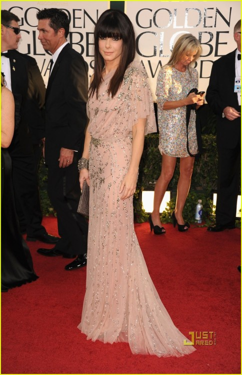 3. Sandra Bullock Last year's Best Actress in a Motion Picture-Drama winner takes the 3rd spot for best dressed. Sandra wore a beige one shouldered Jenny Packham dress. The Grecian dress made the actress look like a red carpet royalty. Stunning!