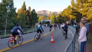 Riders of the 2016 USA Cycling Hill Climb National Championship head to the starting line. Pikes Peak in full view.
