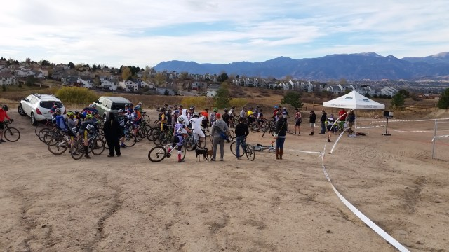 Athletes line up for the start of the first race of the day at the Colorado Springs Cyclocross race put on by RideCo Bike Shop and Cafe Velo.