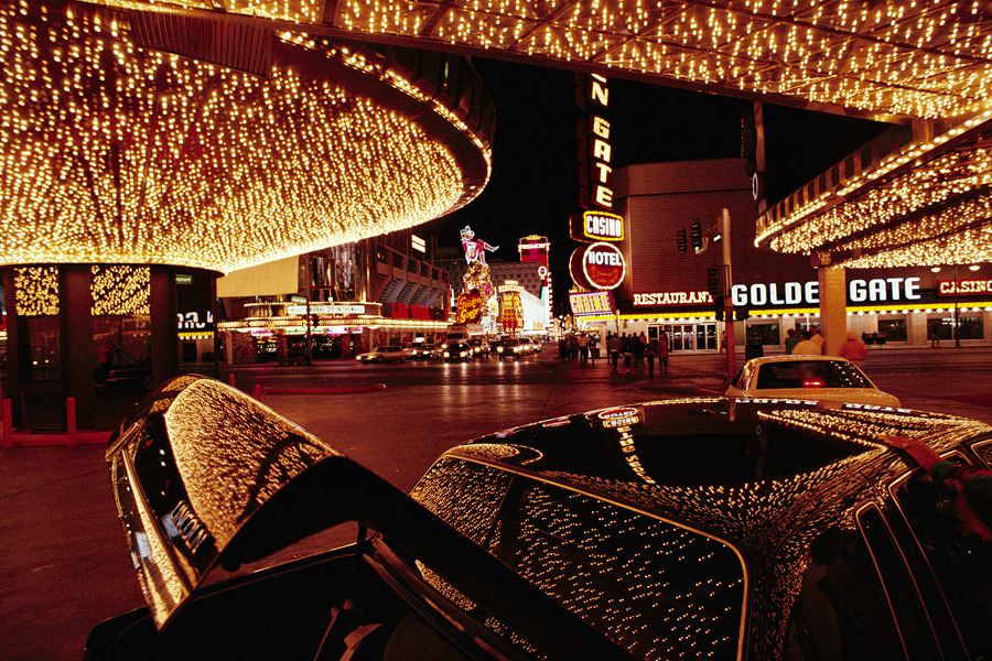 A Las Vegas hotel's neon lights are reflected on a parked car, December 1992.Photograph by Chris Johns, National Geographic