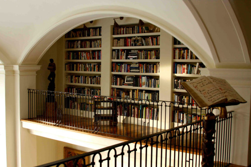Interior designer Matthew White's library gallery, located in the upper level of his living room. (Photo by Art Gray)