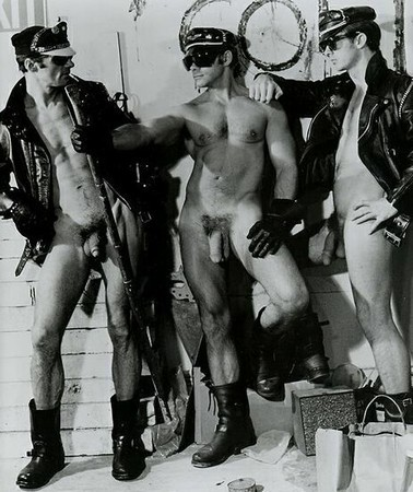 men in black leather chaps