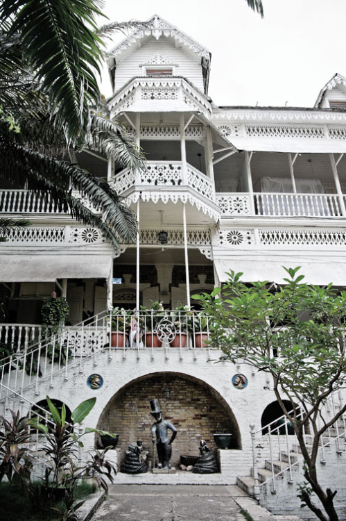 Hotel Oloffson in Haiti, described as a giant haunted doily.
