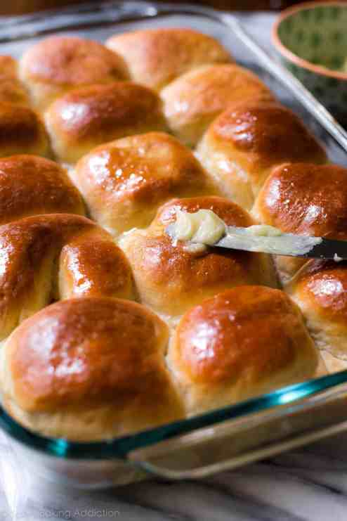 Soft, fluffy, tried & true honey butter dinner rolls recipe on sallysbakingaddiction.com-- step by step photos included!