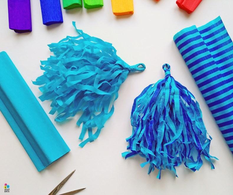 Puszki, które mogłyby skończyć w śmietniku wyglądają teraz bardzo elegancko. Zresztą w taki sposób możecie wykorzystać puszki również na pojedynczy świecznik. Też będzie ładnie!  dekoracja na urodziny - girlanda z bibuły