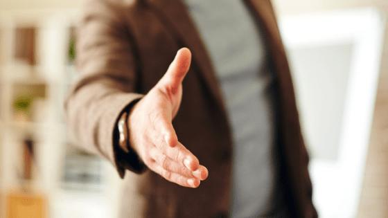 business man reaching to shake hand customer cac