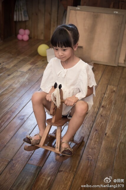 Cindy Tian Yucheng on a wooden horse