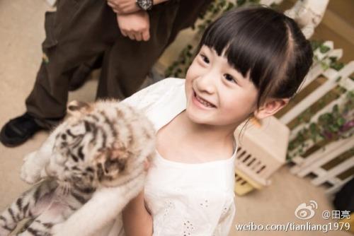 Cindy Tian Yucheng with her pet tiger