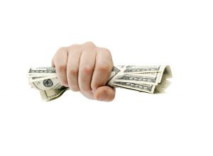 American dollars clenched isolated on white