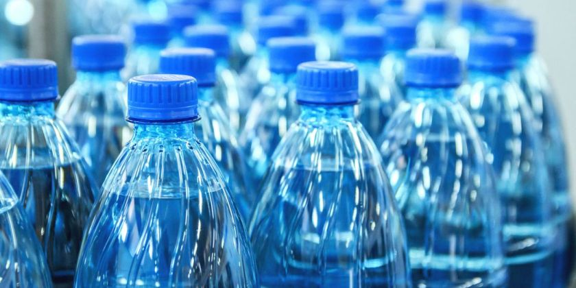 Image of plastic water bottles on production line