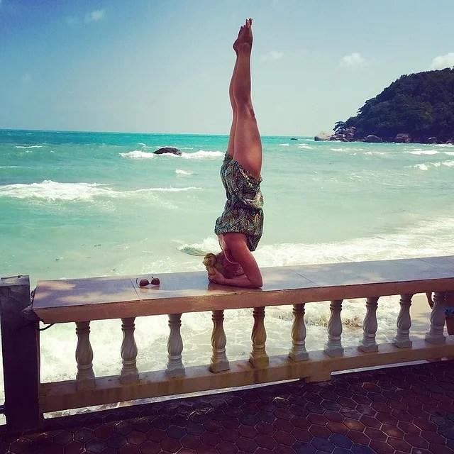 head down yoga position near the ocean