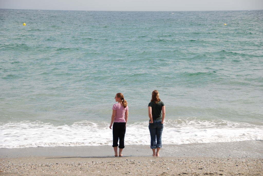 the girls dipping their toes in the Mediterranean