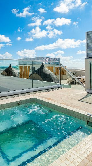 Outdoor Amenities including a Spa Jacuzzi at 3550 South Ocean