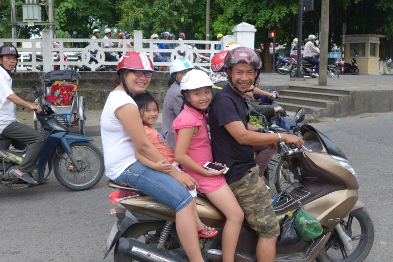 Notice the little one without a helmet…it is believed (I'm not sure how widely) that the helmets will impede the growth of a child's brain and head, thereby negatively affecting their intelligence