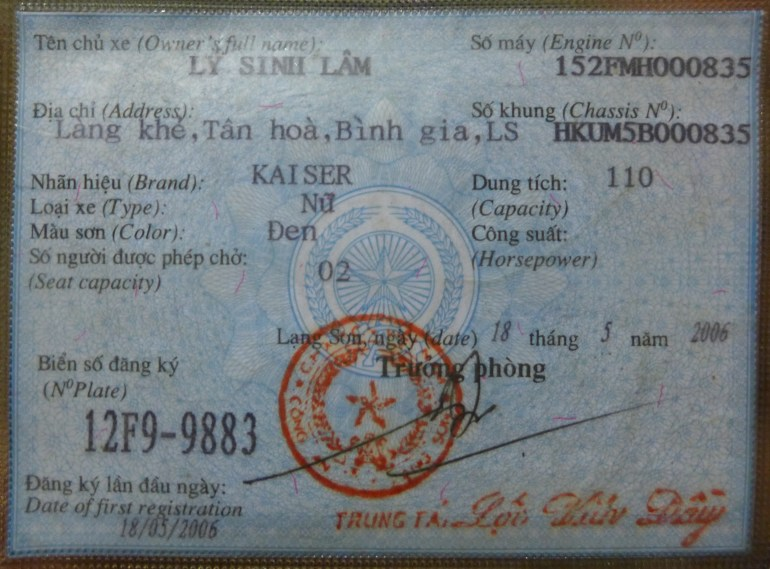 The blue card is essentially the proof of registration and ownership; however, the name on the card belongs to a random Vietnamese person, the original owner of the bike...my bike's owner appears to be Ly Simh Lam