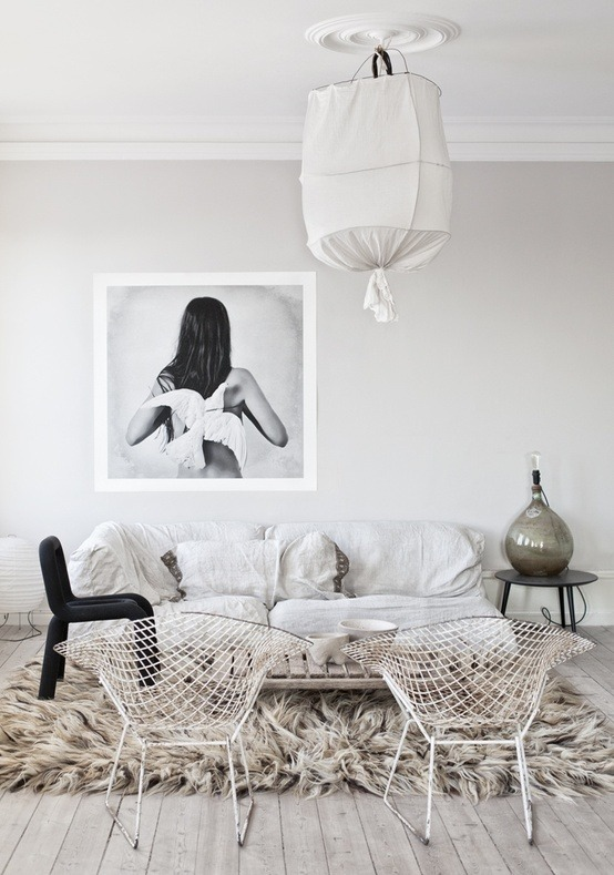 Monochromatic Design White with Black Accents Living Space with Fur Rug and Over-Sized Wall Art