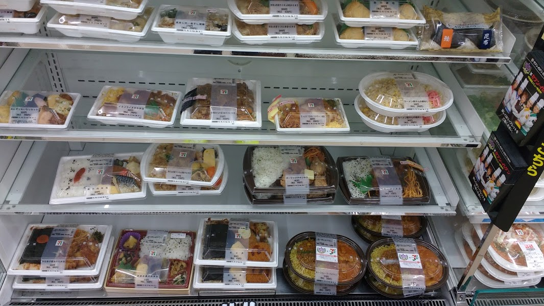 A variety of meals at a 7-Eleven. The cashier can warm up your meal for you in the microwave if you want.