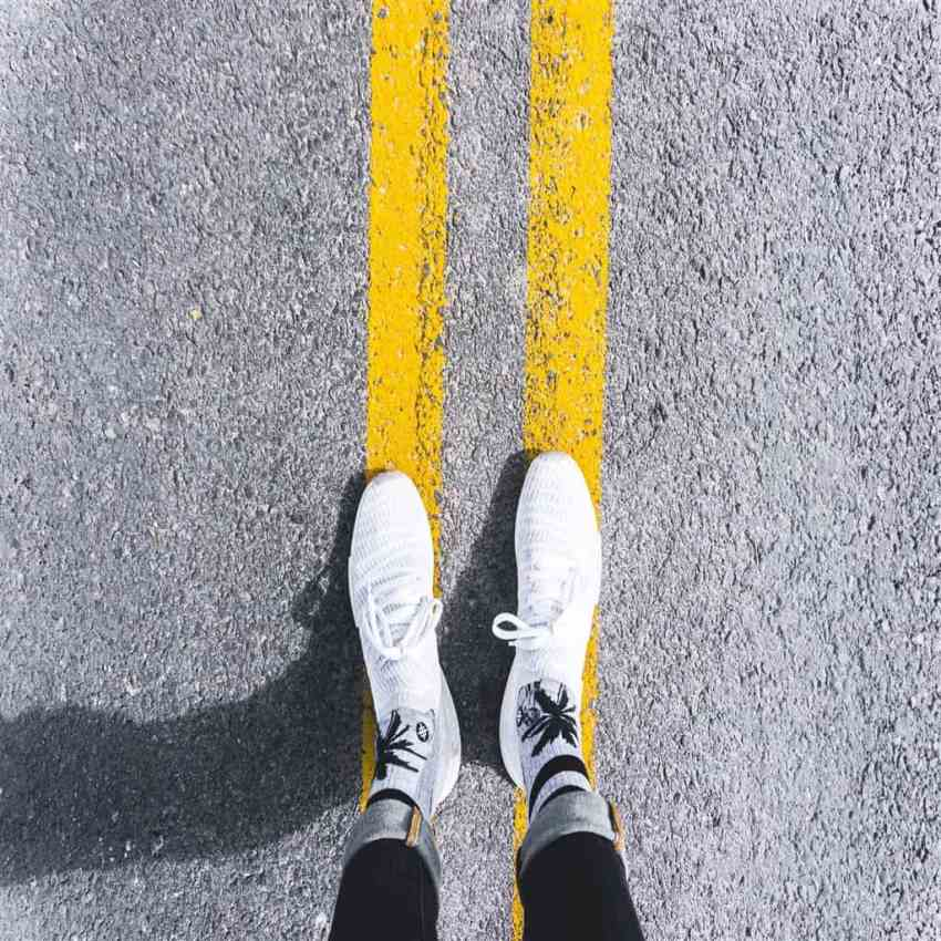 white shoes on double yellow lines