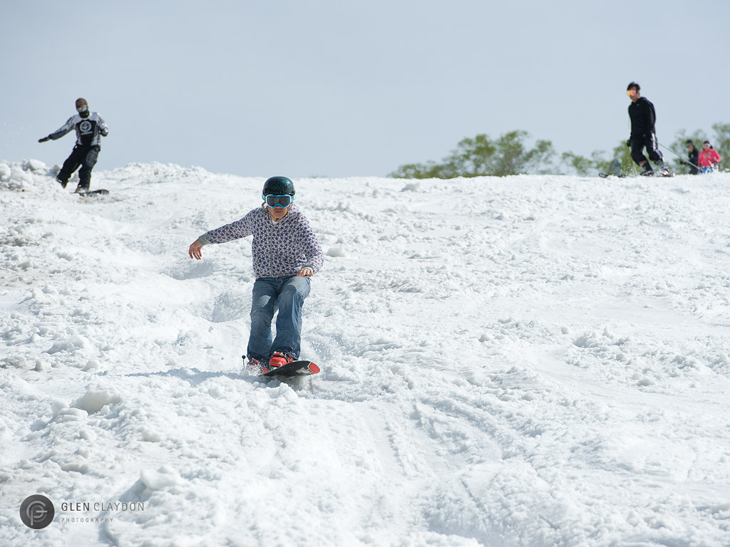 Alpine snowboarder hitting the moguls, 2 June 2013