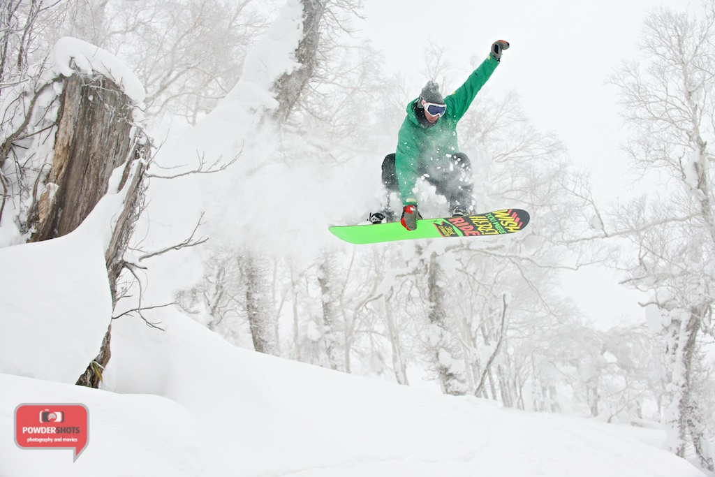 Sam from Niseko Xtreme sending it from a small tree stump