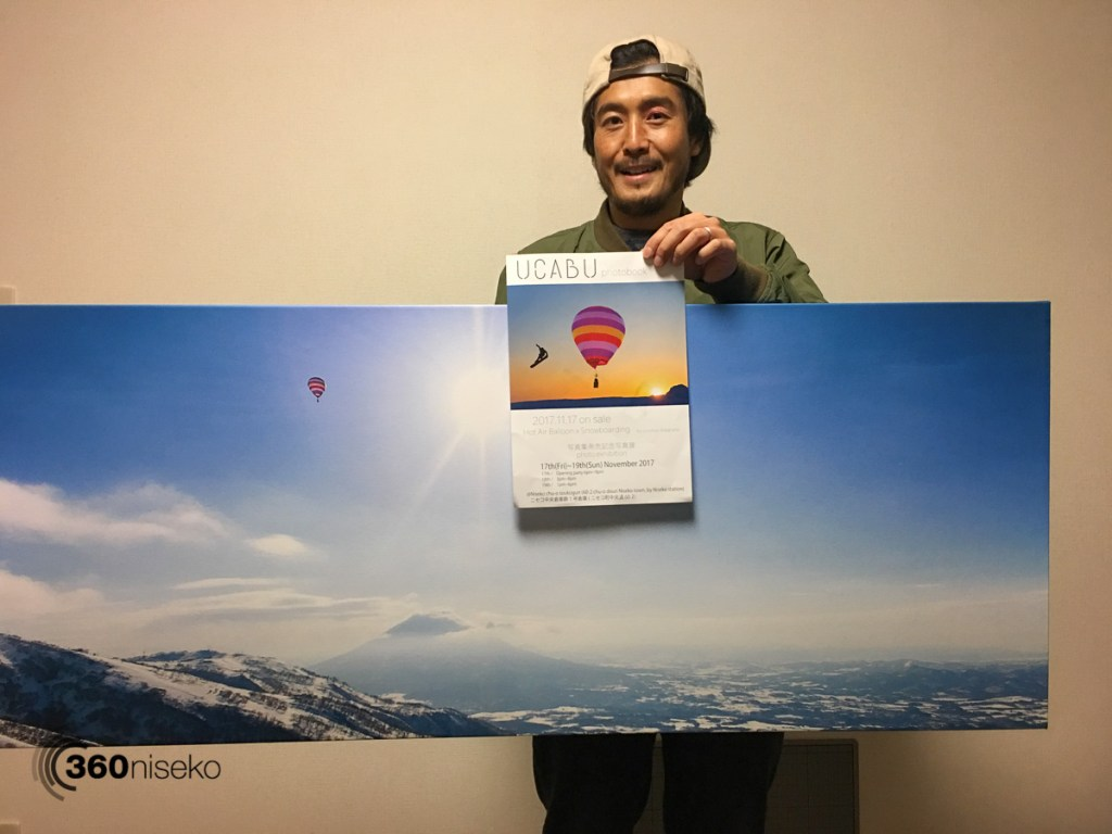 Jun picking up a canvas print for the exhibition, 16 November 2017
