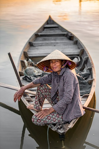 Sau on her boat, Hoi An, Vietnam