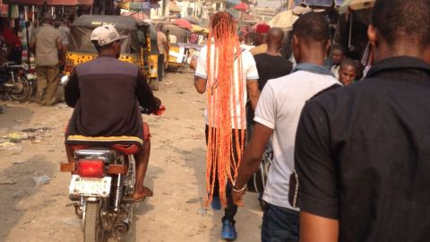 [Photo of The Day] A Very Long Braided Man Spotted in a Nigerian City