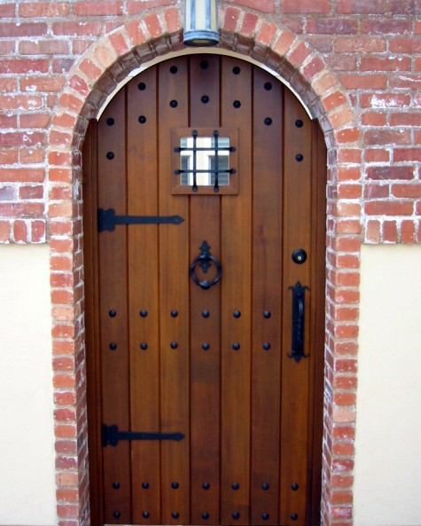 Wooden Entry Door With Wrought Iron Clavos Pull Handles