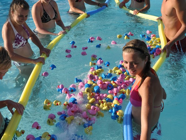 53.  Get Lucky at the Summer Duck Race & Pool Party