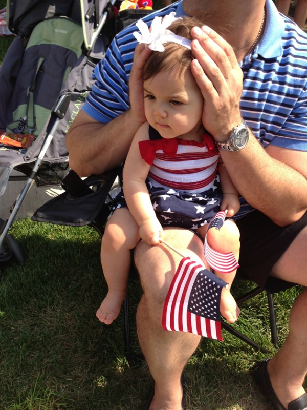 Francesca's first 4th of July!! She loves sitting her daddy watching the parade! - Angela Abbatemarco