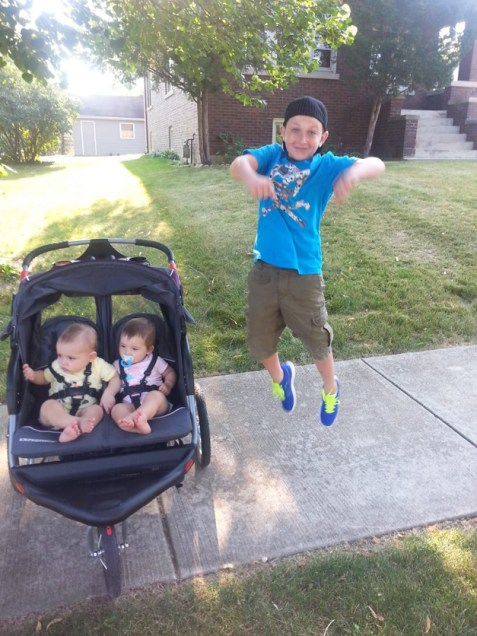 My son Connor, extremely happy to head back to Hough Street School. His twin brother and sister couldn't care less. It was his idea to jump for the photo - Submitted by mom, Jenna