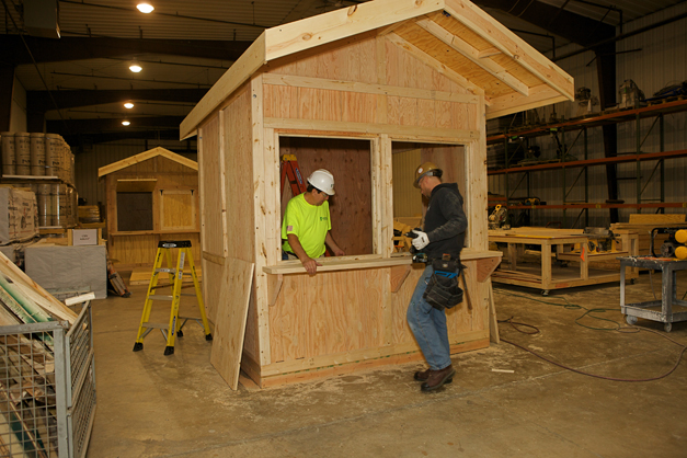 Pepper Construction carpenters building ChristKindlFest houses