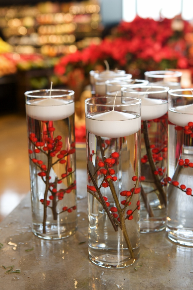 These vases filled with winterberries and candles would make a perfect centerpiece - Photographed by Julie Linnekin