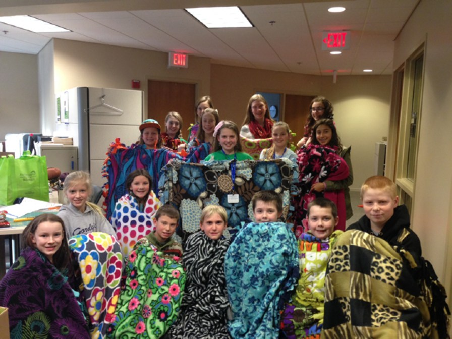 JourneyCare Juniors Make No-Sew Fleece Blankets for JourneyCare Families on Martin Luther King Junior Day