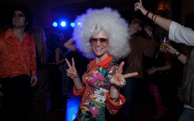 73. Barrington Junior Women's Club Members Return to the 70's to Raise Over $15,000
