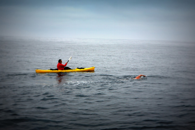 Paddling Along in a Kayak, Don Macdonald Guides Swimmer Doug McConnell During Catalina Channel Swim - Photographed by Susan McConnell