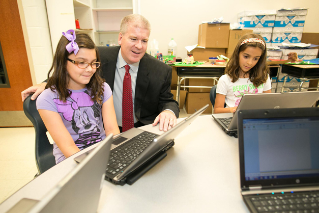 Superintendent Dr. Brian Harris with students at Roslyn Road Elementary School