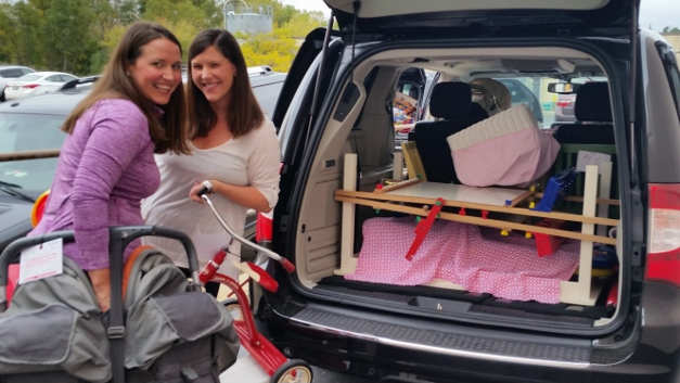 Julie Lape and Kristin Nemec load up their purchases