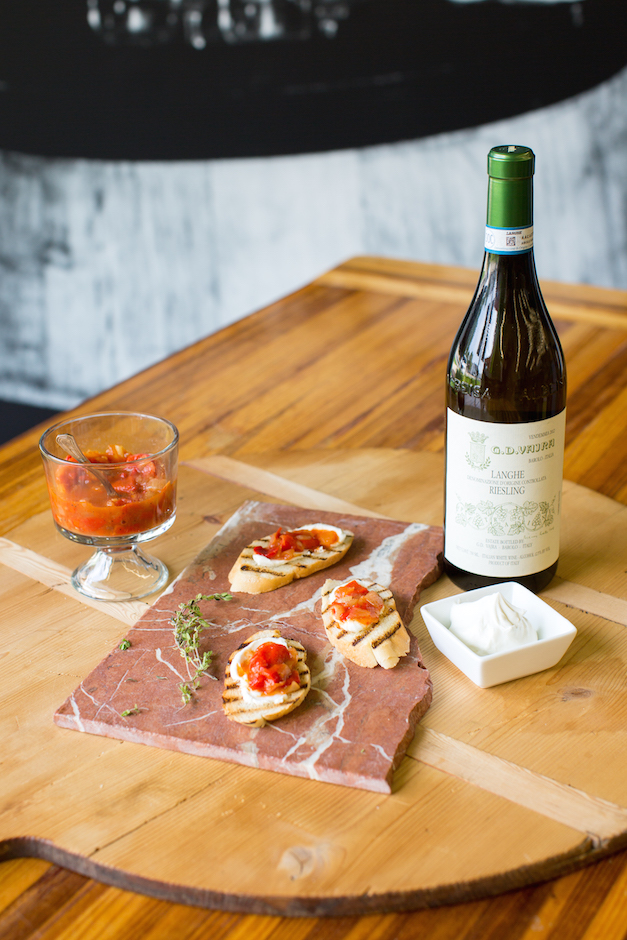 Peperonata with goat cheese on grilled baguette, paired with Vajra's Reisling - Photo by Sally Roeckell