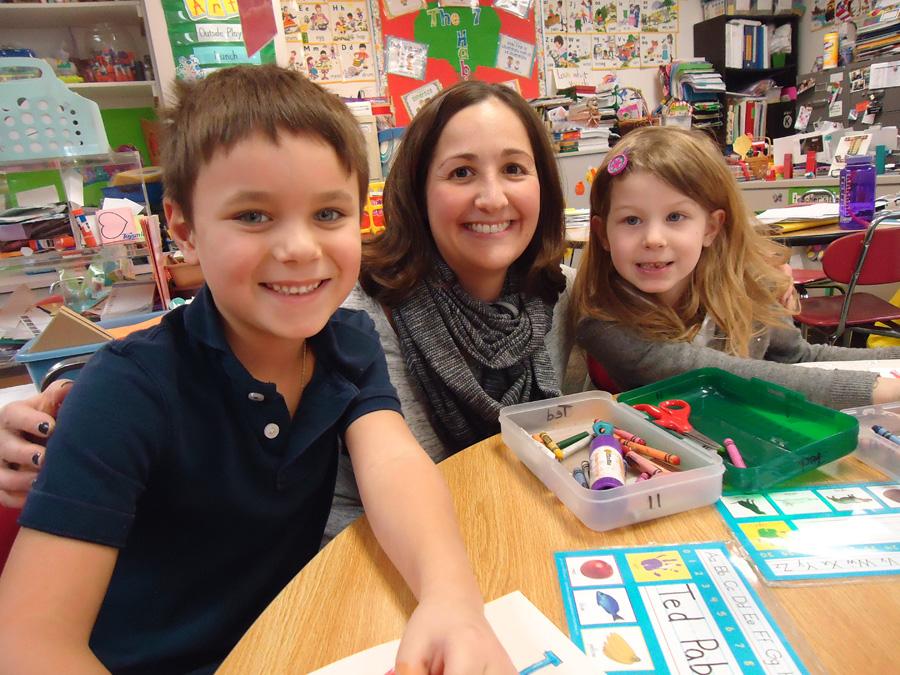 Saint Anne Parish School Kindergarten Teacher, Janinne Joseph, with Students