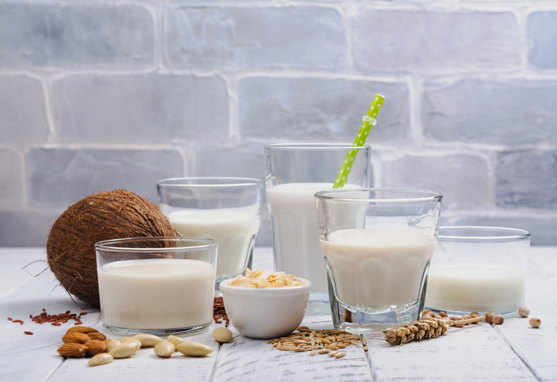Assortment of non dairy vegan milk and ingredients