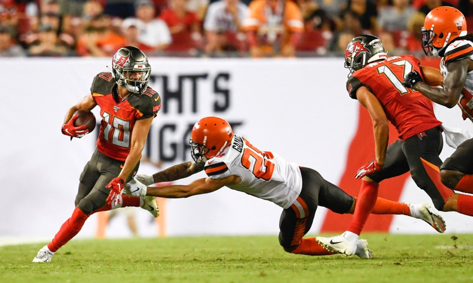 Aug 23, 2019; Tampa, FL, USA; Tampa Bay Buccaneers wide receiver Scott Miller (10) runs with the ball as Cleveland Browns cornerback Phillip Gaines (28) defends during the second half at Raymond James Stadium. Mandatory Credit: Douglas DeFelice-USA TODAY Sports - Photo Shared by Kristy Miller