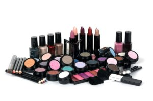 About 365 Cosmetic Reviews Pile of Makeup