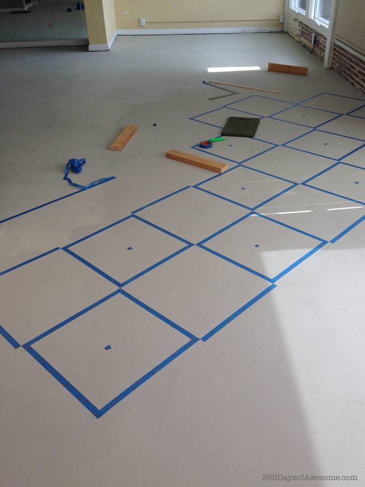 How I painted my concrete skim coated floors with Annie Sloan Chalk Paint in checkered squares on the diagonal.