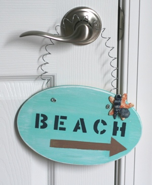 Handpainted Beach sign with molded clay accents.