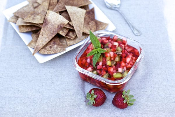 Delicious Strawberry Salsa with Kiwi served with cinnamon sugar pita chips. Makes for the perfect BBQ appetizer or dessert.   365 Days of Easy Recipes